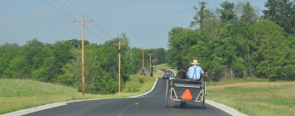 An open buggy moves along Route 11 in Highland County, Ohio