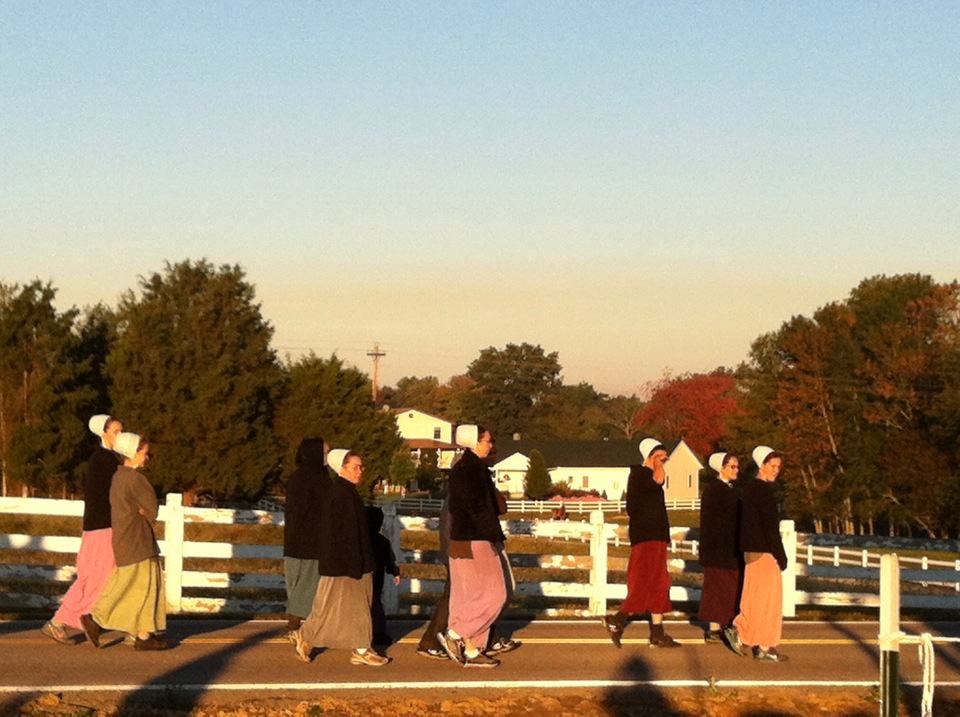Amish women lace up to  walk in the Adams County Marathon