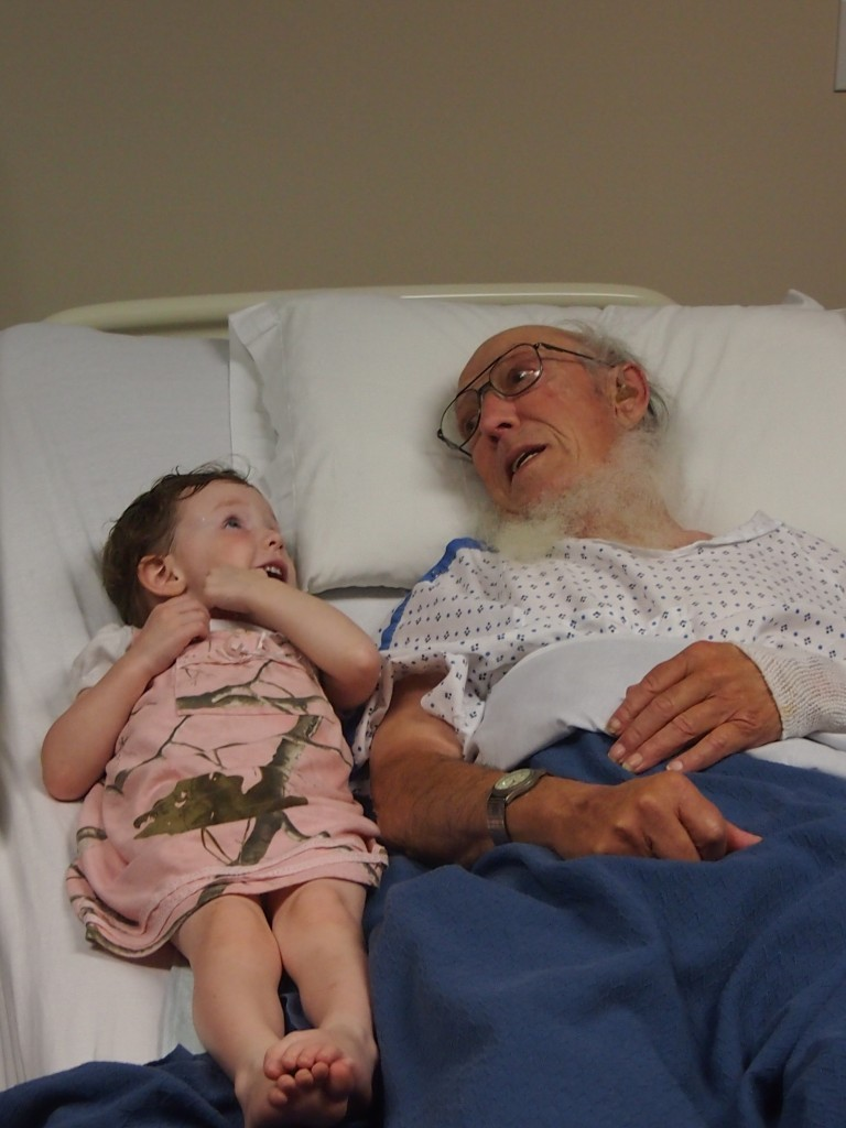 Ava, age 2 in this photo resting with her grandpa Bauman, is now 4 years old and has a new sister! Welcome, Arabella Kate!