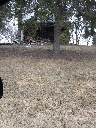 A burned out home on Ohio State Route 235...the home is uninhabitable, but it looks like someone is storing firewood in it