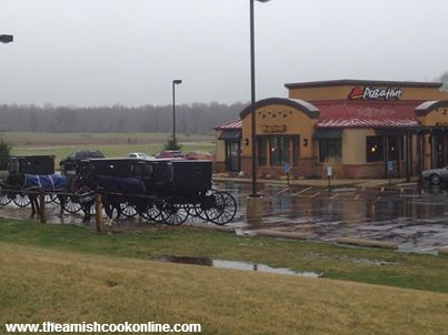 Buggies pack a Pizza Hut parking lot outside of Shipshewana