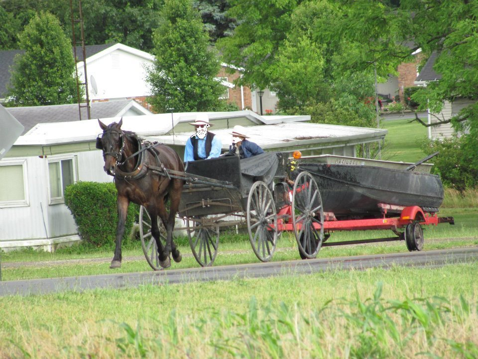 Amish men towing a boat near Indian Lake in Ohio