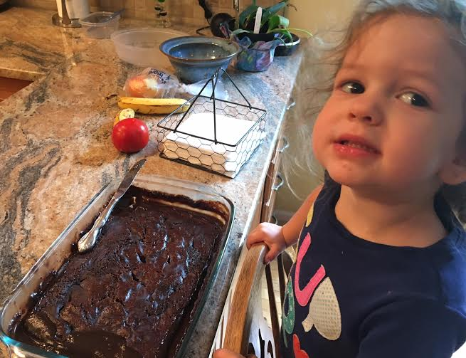 My 2 1 /2 year old daughter, Aster, with our Hot Fudge Cake...we took it over to my parents so they could help sample it!