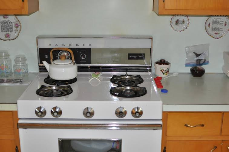 Lovina Gingerich's gas stove...her kitchen is a tidy icon from another era...
