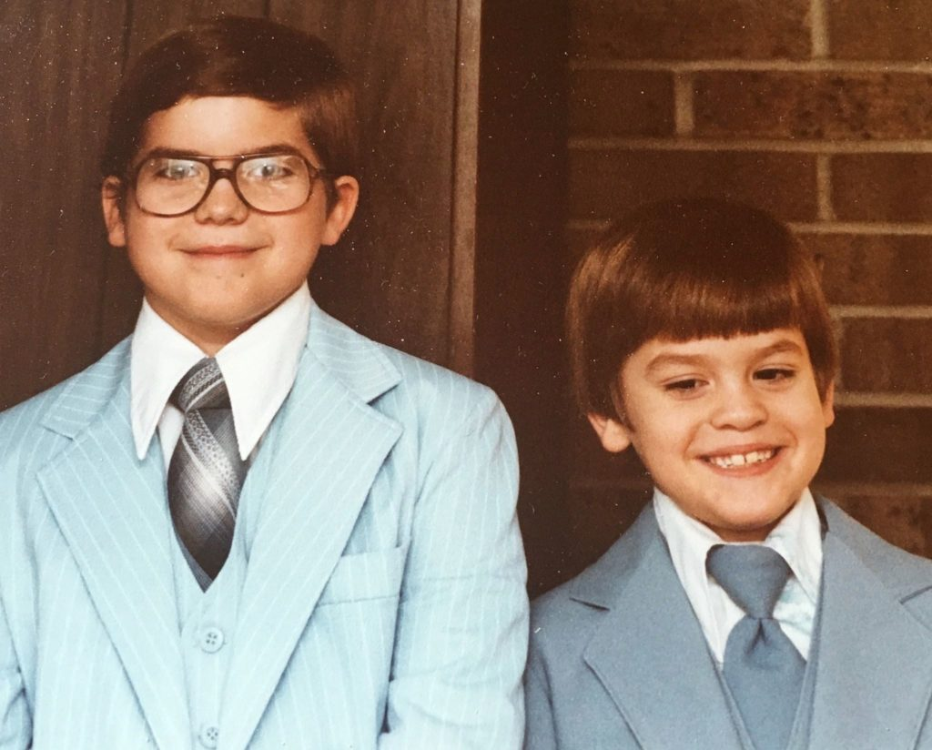 My brother Geoff, age 11 and me, age 8....all dressed up.  Ha, I bet that is a clip-on tie I am wearing!