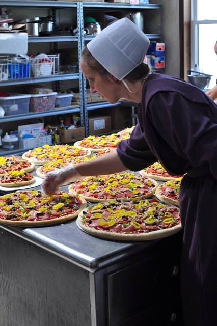 Marie Mast makes the pizzas...
