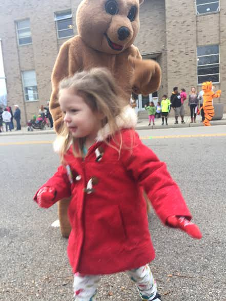 "Happy with her ""bear hug"", Aster heads back to join me in watching the parade."