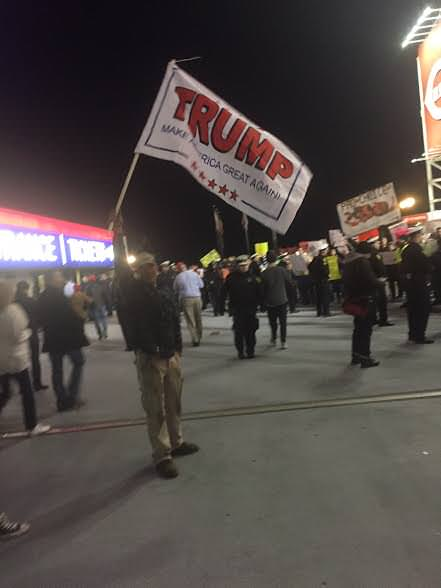 A Trump supporter waves a flag.