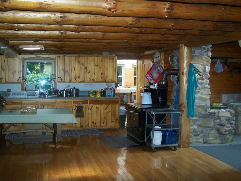 A spacious kitchen in an Amish home....warm, rich knotty pine gives this a very homey feel...