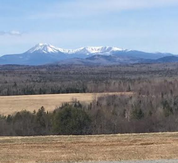 A view of snow-capped Mt. Katahdin from an Amish farm outside of Patten, Maine, one of many new communities that have cropped up in that state in recent years...